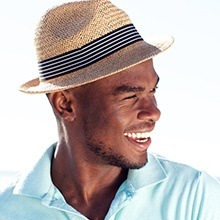 Man with a sun hat smiling