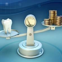 A scale holding a tooth on one end and money on the other end