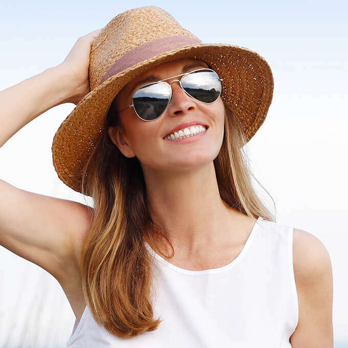 Smiling woman in sun hat