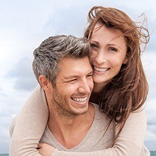 Smiling couple with healthy teeth