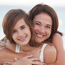 Mother and daughter sharing healthy smiles