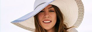 Woman with gorgeous smile wearing a large hat