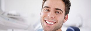 Young man sharing healthy happy smile