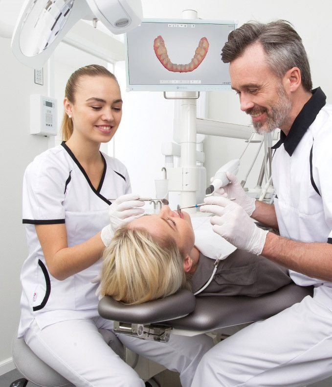 Woman receiving dental care in high tech office