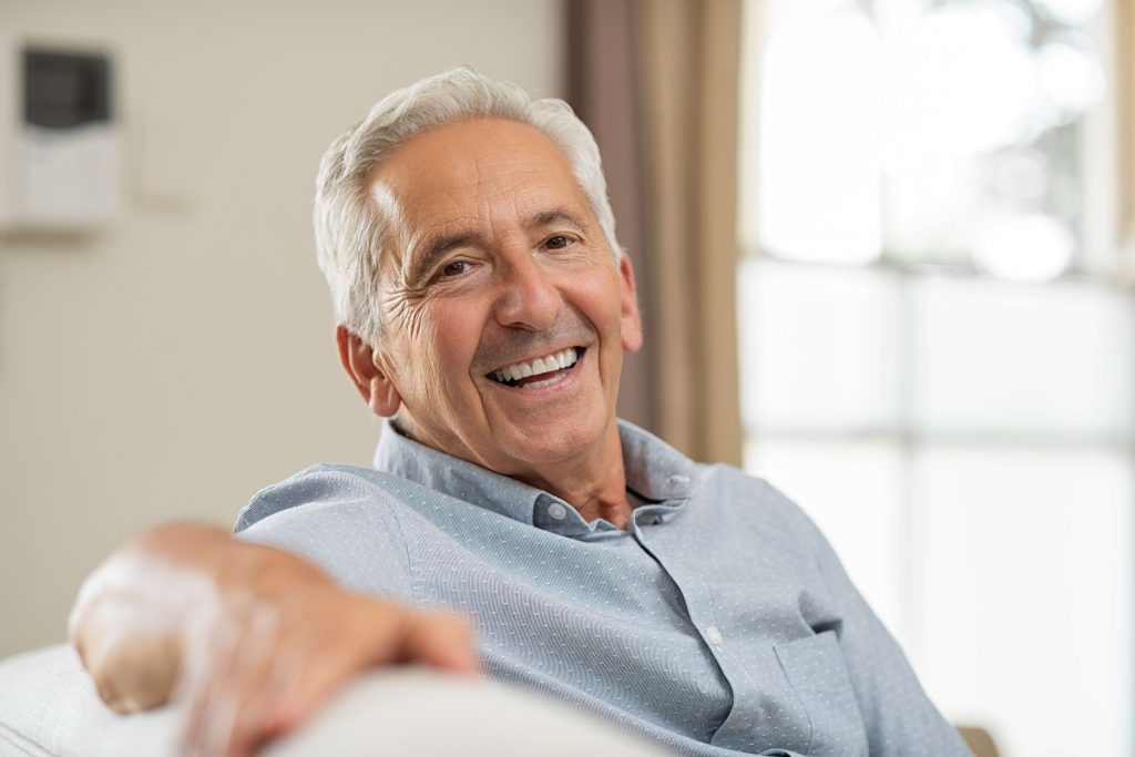 Older man smiling.