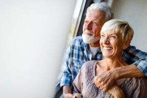 Happy older couple with dental implants in West Palm Beach