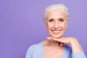 Smiling woman with healthy dental implants in West Palm Beach